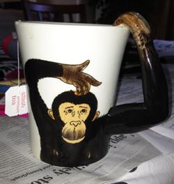 Monkey mug full of Stash hot tea on humor blog Tall Curly Biscuit