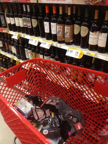 We left our funny cart staging basket inspired by Shades of Grey in the wine isle.