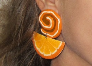 Closeup of my awesome orange slice earring from 1988. They go with my bangs.